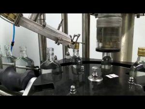 vinflaskans skruvkapselmaskin
