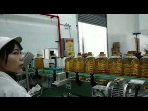 smörjande mobilmotor hydraulisk bilpump olja flaskan fylla produktionslinjen maskin